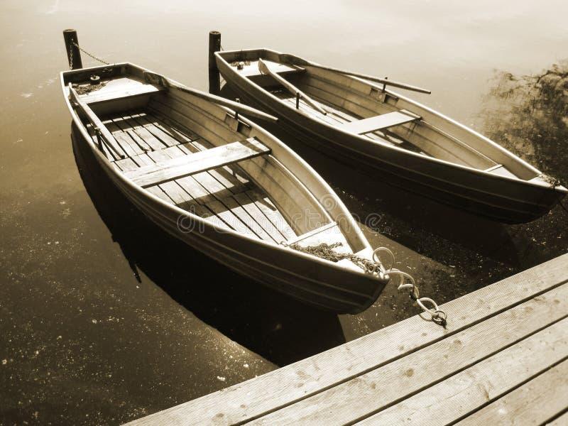 Boat on the lake (20), sepia royalty free stock photo
