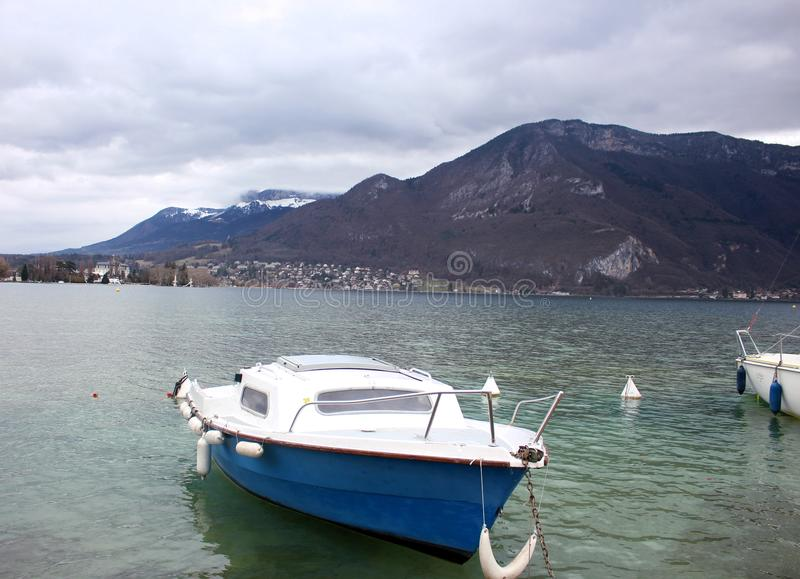 Boat on Lake Annecy overlooking the French Alps stock photos