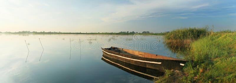 Boat on lake. Boat on big lake in morning royalty free stock photo