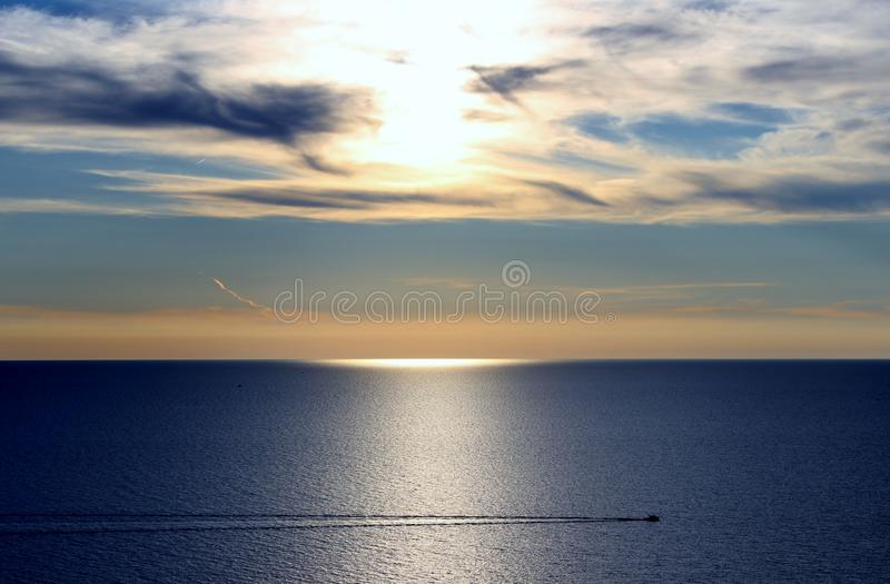 Boat on Lake Michigan. A lone boat sails across Lake Michigan before sunset royalty free stock images