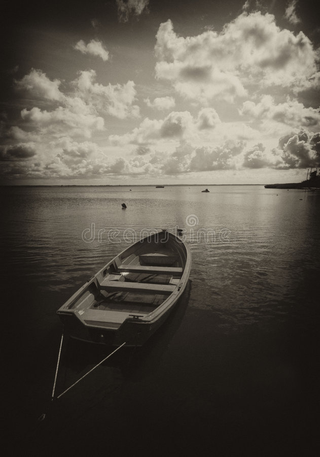 Boat on lake in sepia royalty free stock images