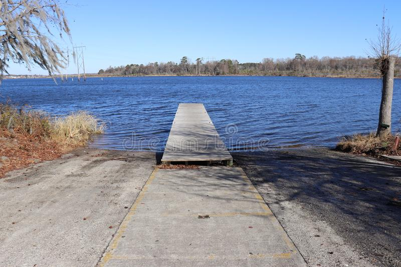 Boat landing with dock in public park stock photo