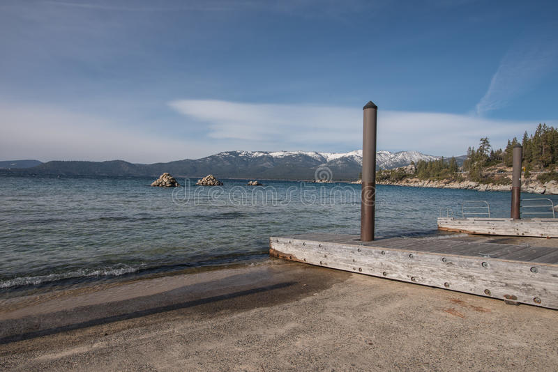 Boat Launch Facilities and Docks in Kings Beach State Recreation Area, Lake Tahoe. Lake Tahoe is a large freshwater lake in the Sierra Nevada Mountains royalty free stock images