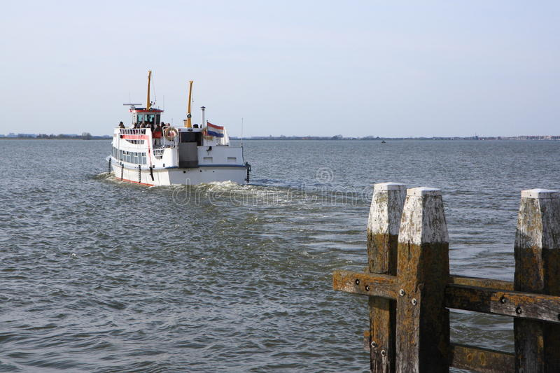 Boat leaving port. A small ferry is leaving port royalty free stock image