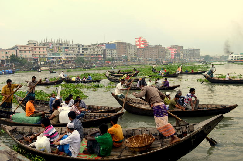 Boat and life in Dhaka. Dhaka, the capital of Bangladesh is situated on the bank of river Buriganga. The people of the other bank come to Dhaka for trade and royalty free stock images