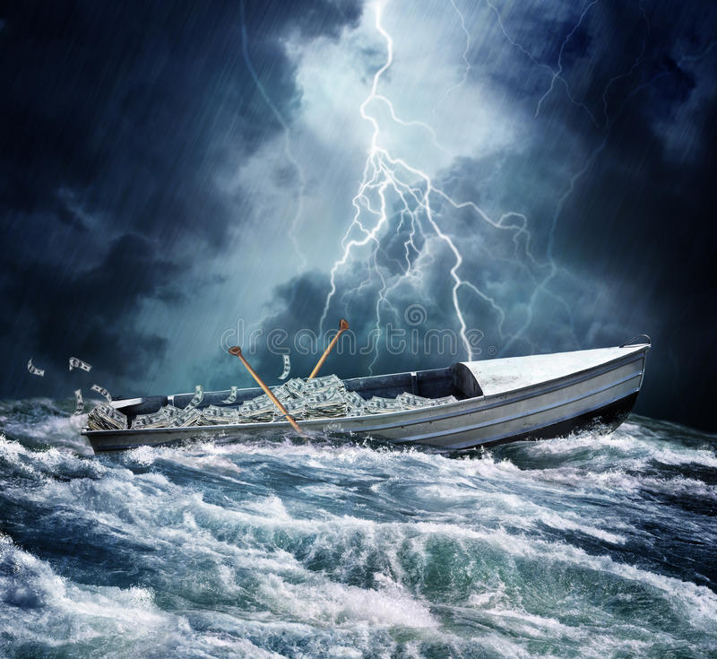 Boat load of money. A boat filled with money in rough waters or seas with a stormy sky and lightening. Concept for risk and money management stock photos