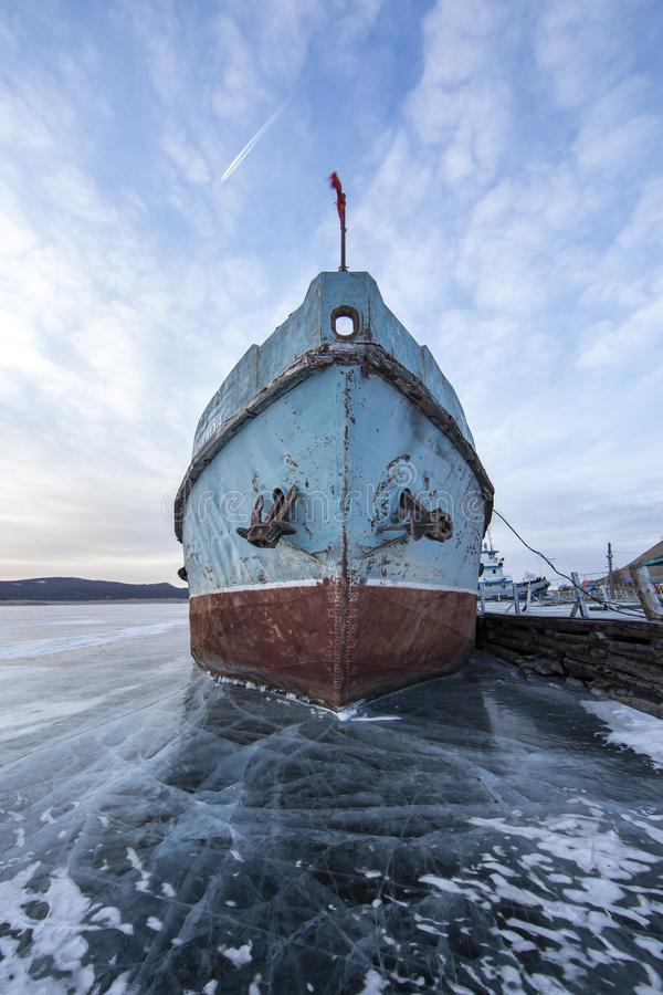 boat locked in ice in a frozen lake Khuvsgul in northern Mongolia royalty free stock images