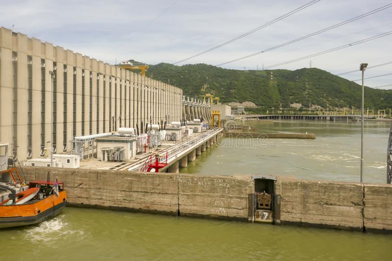 Boat in locks of Iron Gate Hydroelectric Plant. Iron Gat Hydroelectric Plant in the Iron Gate gorges on the Danube River between Serbia and Romania stock photography