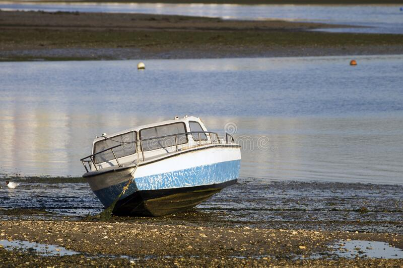 Boat in low tide royalty free stock images