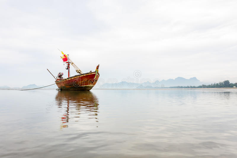 A boat on the low tide beach royalty free stock images