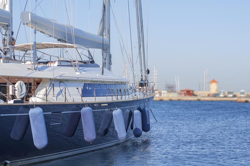 Boat luxury side docked on marine harbor port with clean sky royalty free stock images