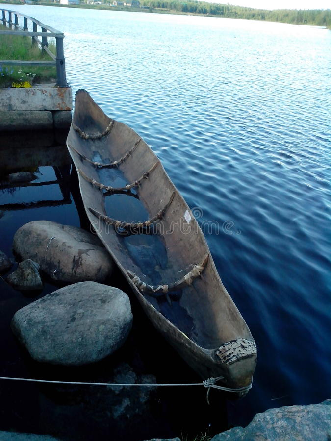 A boat made from a whole tree trank royalty free stock photo