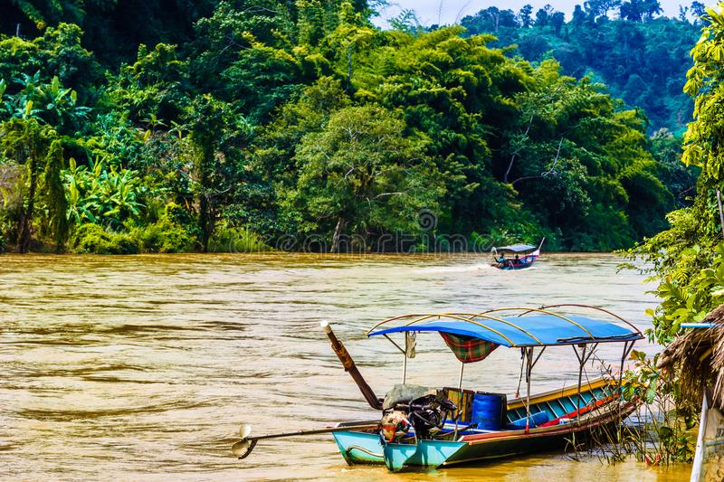 Boat on Mae Nam Kok river by Chiang Rai - Thailand. View on boat on Mae Nam Kok river by Chiang Rai - Thailand stock photography