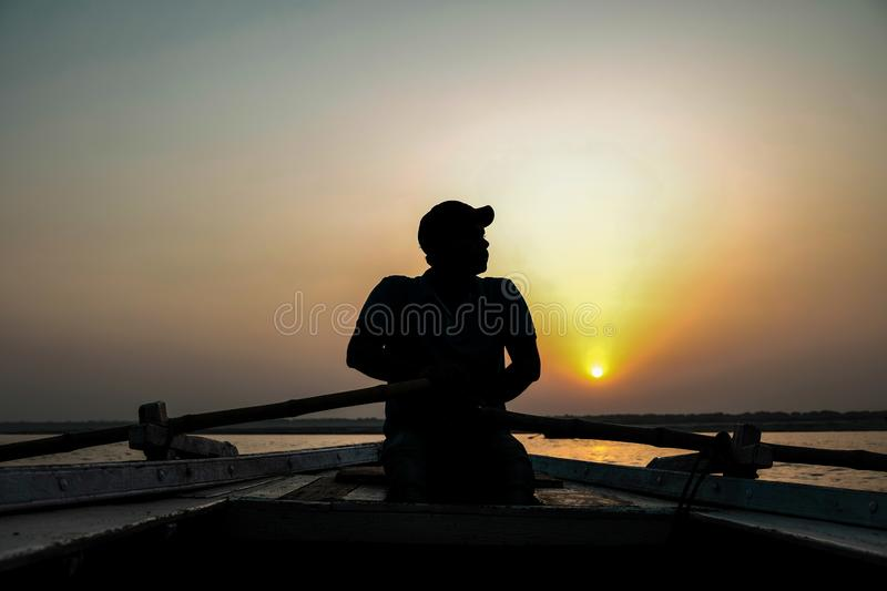 Boat man riding a boat in Holy River Ganges. stock photo