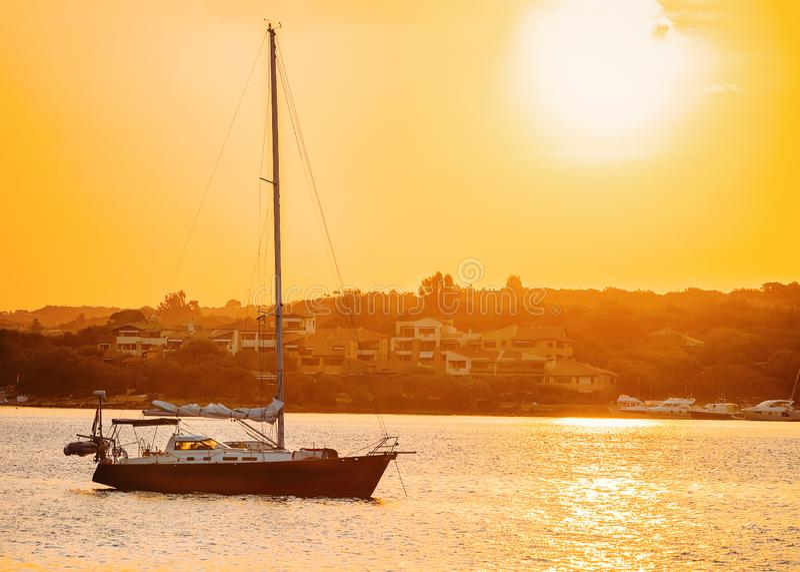 Boat at the Mediterranean Sea in Costa Smeralda. In Sardinia in Italy at sunrise stock photos