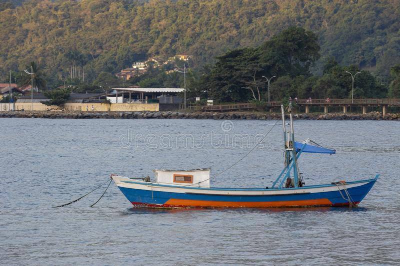Boat moored in the calm waters. Of the river delta. Bertioga city, Sao Paulo state, Brazil stock images