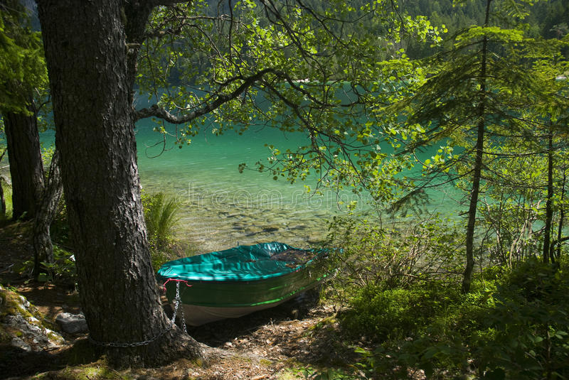 Boat moored in tovel's lake stock photography