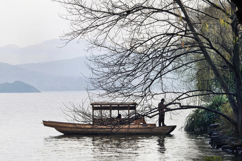 Boat moors at the bank of West Lake, Hangzhou, China stock image