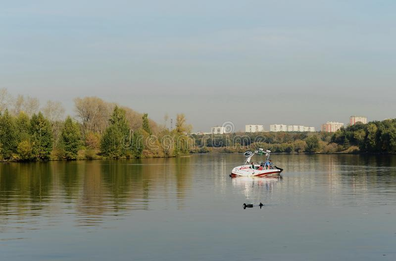 Boat on the Moscow River in the Silver Forest. royalty free stock photography