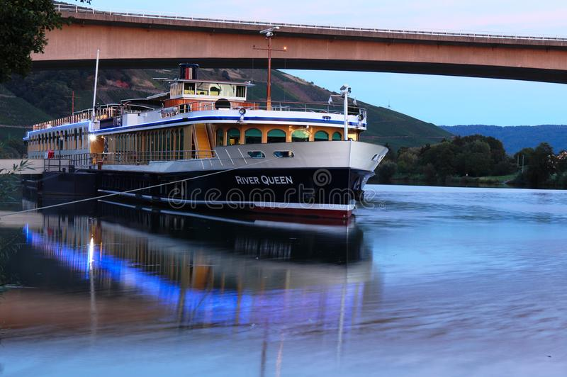 A boat on the Mosel at sunset stock photos