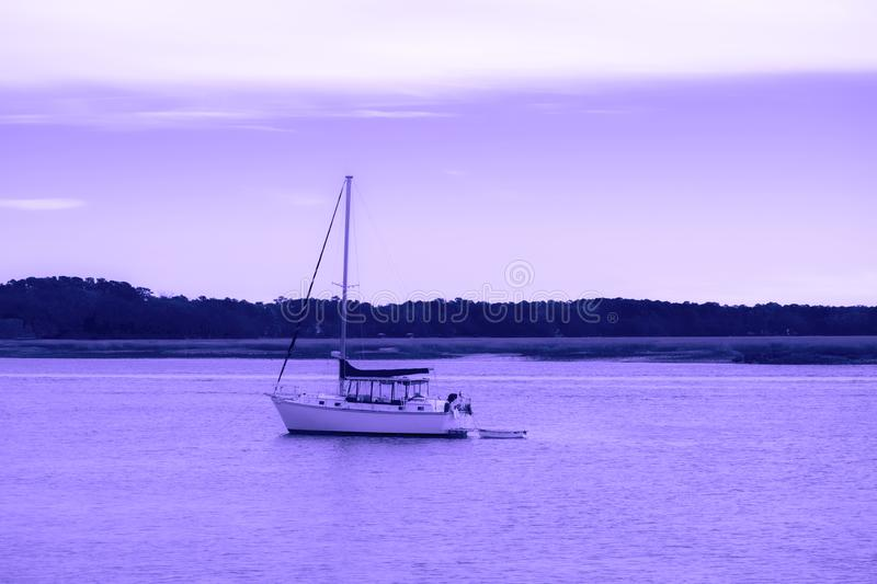Boat. Motor boat in a river on a violet sky and reflection to river royalty free stock photos