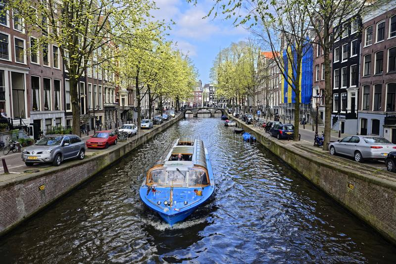 Boat on canal in Amsterdam royalty free stock photo