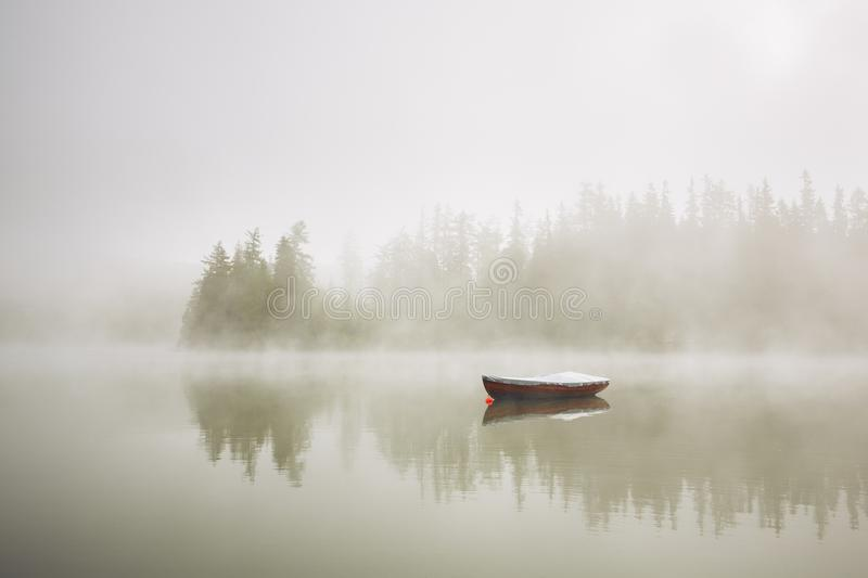 Boat in mysterious fog stock image