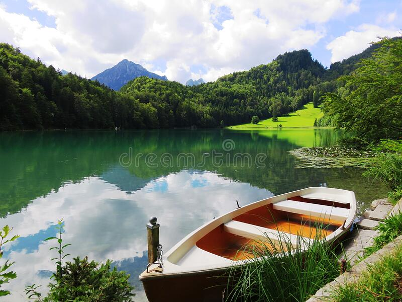 Boat near lake in the mountains stock images