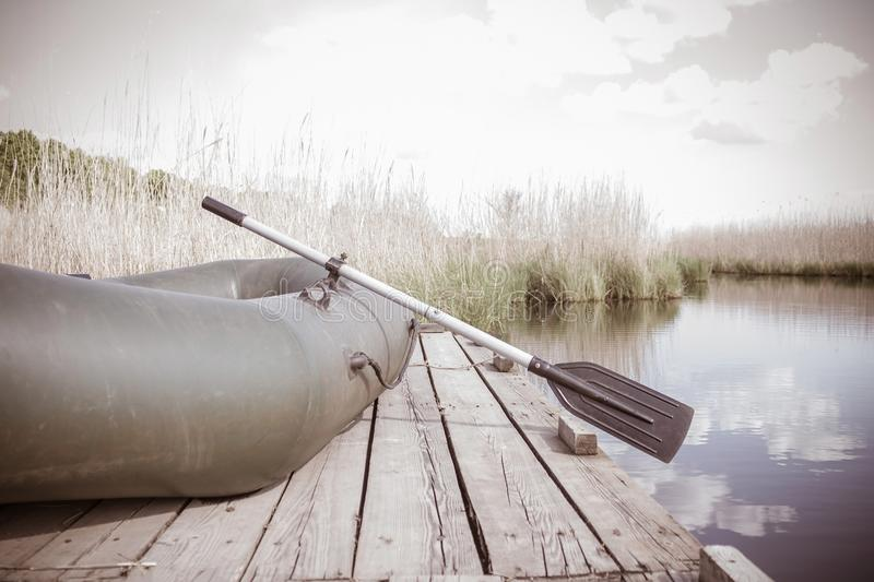 The boat is near the lake, the river. royalty free stock image