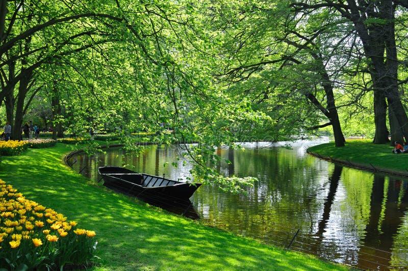 Boat near the river in Keukenhof park royalty free stock images