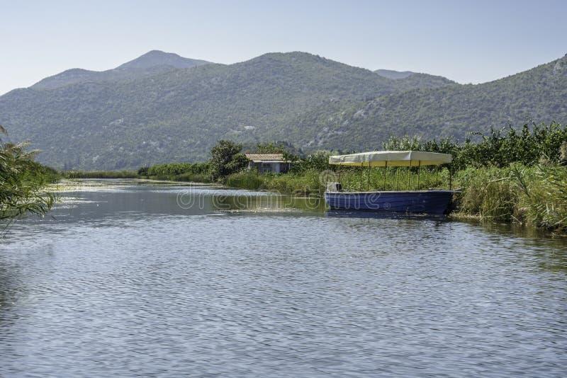 Neretva river. Boat in the neretva river in Croatia stock images