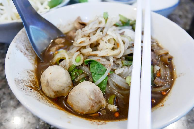 Boat noodle Thai food in the table. Boat noodle Thai food with meat ball and vegetable in the table royalty free stock photos