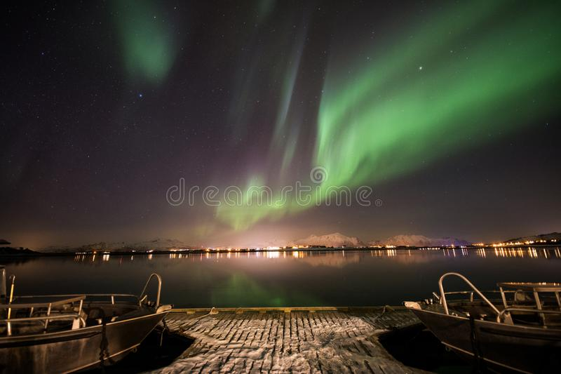 Boat with northern lights background stock photography