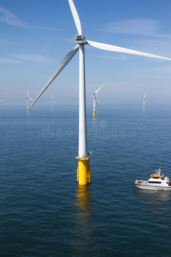 Boat in offshore windfarm royalty free stock images