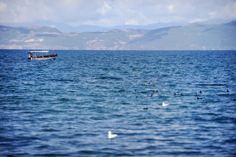 Boat on Ohrid Lake. Passenger boat cruising on the Ohrid Lake in Macedonia royalty free stock photo