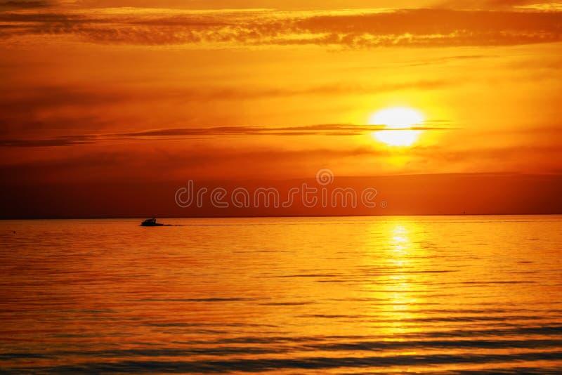 Boat and orange sunset royalty free stock image