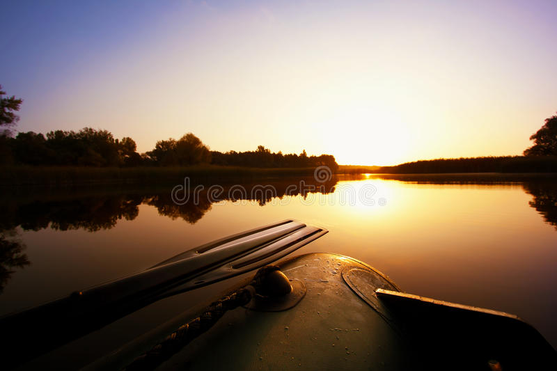 Boat with a paddle on the lake royalty free stock photography
