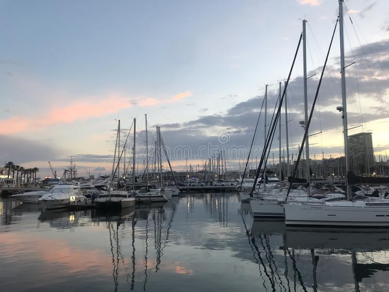 Boat parking, sunset over the port of Alicante, Spain stock image