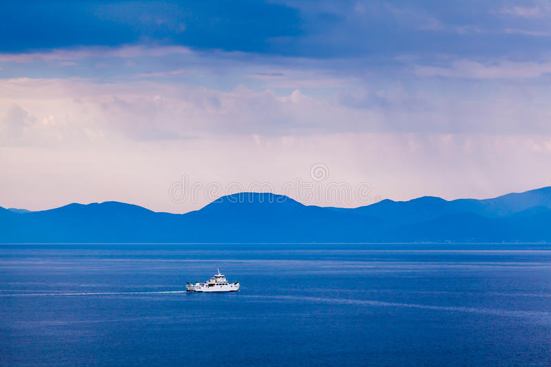 Boat Passing Island of Brac in the Rainy Morning royalty free stock photography