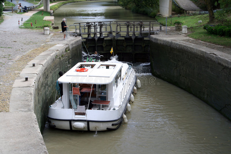 Boat passing a lock stock photography