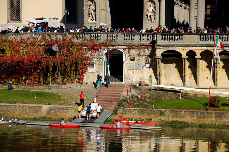 The boat people near Arno River royalty free stock photography