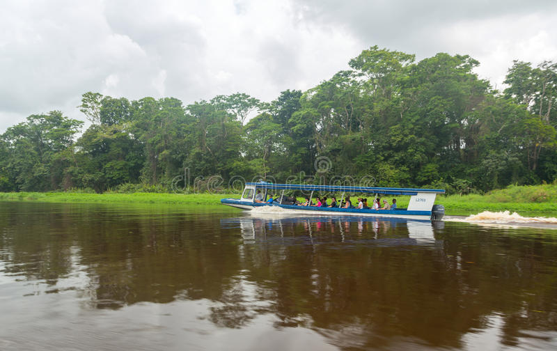 Boat with people visiting national park in Costa Rica royalty free stock image