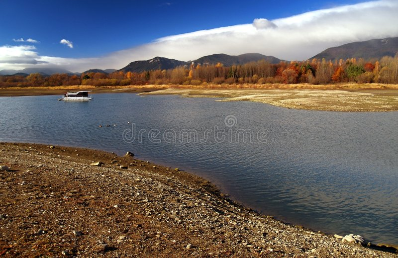 Boat on picturesque lake royalty free stock image