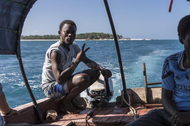 Boat from Prison Island to Zanzibar Town stock photos
