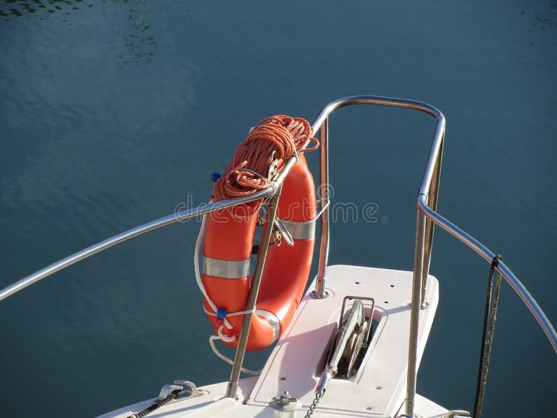 Boat prow with orange lifebelt on the sea water . Rescue concept stock images