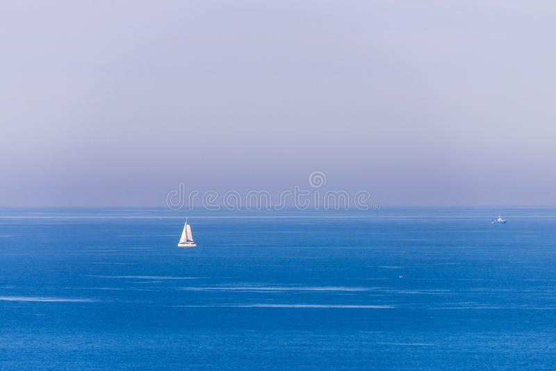 Boat racing across open ocean water. Boat speeding in the sea. Minimal nature photography. Beach view of maritime transportation. Minimal abstract nature stock image