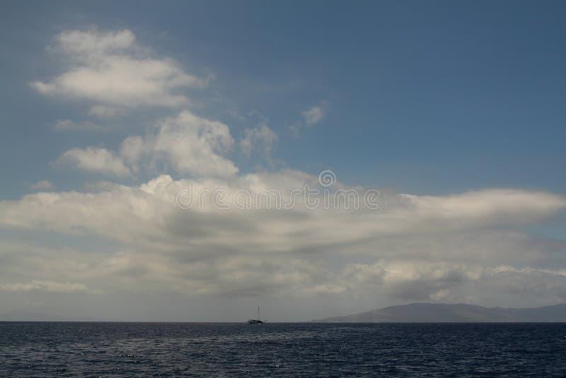 Boat racing across open ocean water. Boat speeding in the sea. royalty free stock image