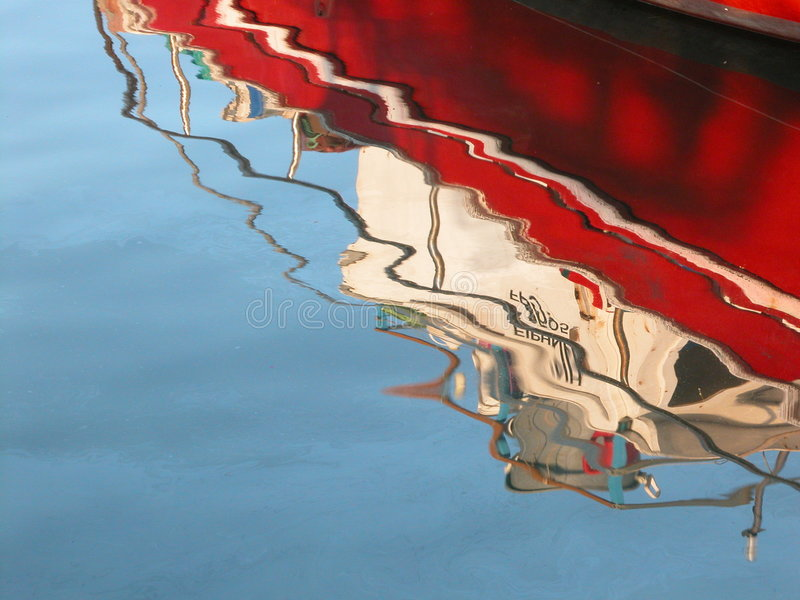 Red Boat reflection on water royalty free stock images