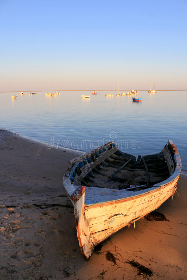 Boat in Ria Formosa park, Algarve. Old boat at sunset in Ria Formosa, natural conservation park, Algarve. Portugal royalty free stock images