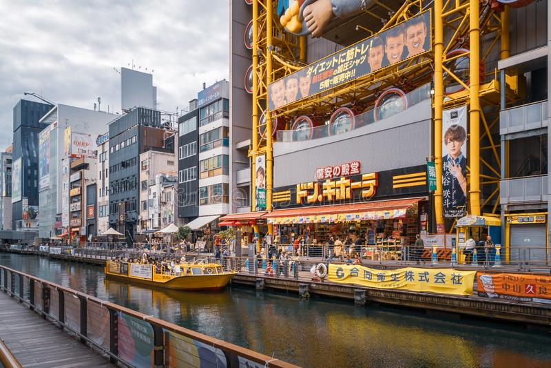 Boat ride near the famous Dotonbori Street in Osaka. Osaka, Japan -November 1, 2018: Tombori river walk and boat ride near the famous Dotonbori Street - Popular royalty free stock image